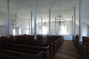 The sanctuary on the second floor speaks to that faith's simplicity of worship and Biblical basis with the pulpit as the centerpiece. A divider separated men and women in their black walnut pews. - PHOTO COURTESY OF BISHOP HILL STATE HISTORIC SITE
