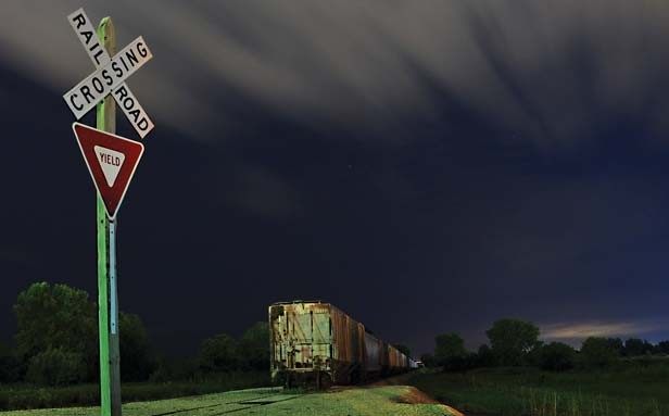 "Second place, Adam Smith of Springfield for ""Meet you at the Crossroads."" Smith tries to grab the viewer's attention. ""This image was structured to capture the movement of the clouds and the sign with the t"
