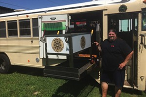 Carl Blake loading a custom American Hot Box on Bertha Bus