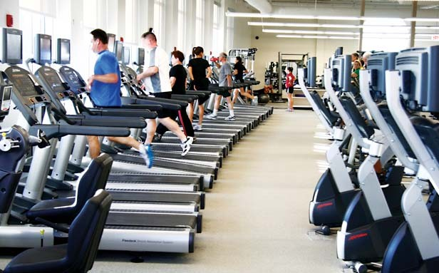 At this time of year, aerobic exercise equipment like these treadmills at the Kerasotes YMCA are in heavy use. - PHOTO BY PATRICK YEAGLE