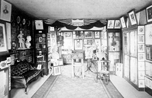 Osborn Oldroyd sold this souvenir photo of his Lincoln museum, located on the first floor of the Lincoln Home, for twenty-five cents. Descriptions of the numbered artifacts were printed on the back of the photo. - PHOTOCOURTESY OF THE LINCOLN HOME NATIONAL HISTORIC SITE