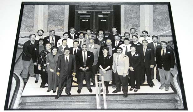 Statehouse reporters in 2000 gather outside the Capitol's press room. - PHOTO BY RANDY SQUIRES COURTESY OF THE ILLINOIS LEGISLATIVE CORRESPONDENTS ASSOCIATION