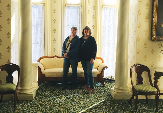 Annie Jansen and her sister, Joanie, tour the Oakland Mansion.