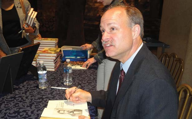 Springfield author David Joens at a recent book-signing event. - PHOTO AT RIGHT BY GINNY LEE