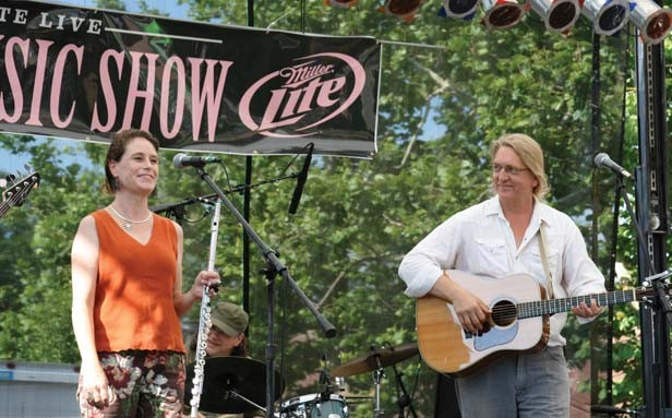 Tom Irwin performing with Theresa O'Hare at the Taste of Downtown last year. - PHOTO BY STEIN DESIGN