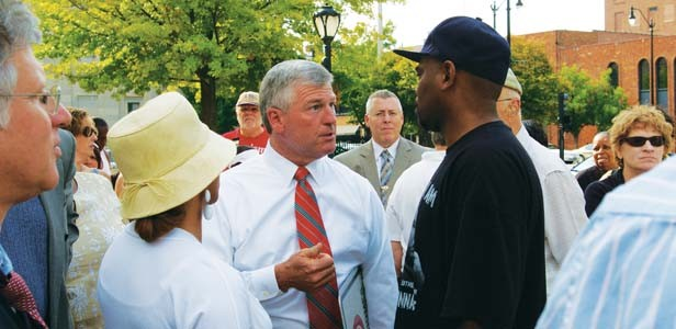 Mayor Tim Davlin talks to Mike Williams and his wife, Doris, at the Aug. 5 protest. - PHOTO BY R.L. NAVE