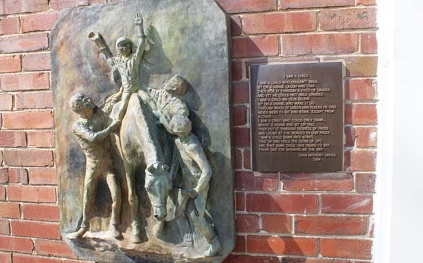 "The ""I Saw a Child"" relief created by artist Ann Frey. She built the artwork in the 1960s after she read the poem  ""I Saw a Child"" by John Davies."
