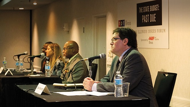 Sean Crawford (right) participating in an AARP-sponsored forum regarding the state budget impasse. - PHOTO BY CARTER STALEY
