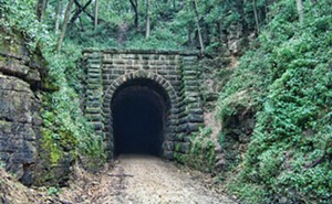 The ominous-looking entrance to the Stewart Tunnel adds to the adventure of the Badger State Trail. - PHOTO COURTESY WISCONSIN DEPARTMENT OF NATURAL RESOURCES