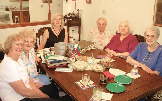 Lithuanian-American Club members (clockwise from top) Sandy Baksys, Ann (Pavemetski) Traeger, Irene (Pietrzak) Blazis, Fritzi (Stankanvich) Cartwright, Louise Sitki and Helen Rackauskas meet at the latter's home to reminisce about St. Vincent de Paul pari - PHOTO BY WILLIAM FURRY
