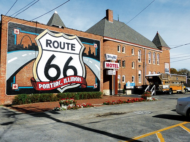 A mural highlighting Pontiac's connection to Route 66 graces the back of the museum complex in this central Illinois town. The school bus/home of Springfield-area resident and Route 66 aficionado Bob Waldmire sits in the parking lot. - MARY BOHLEN
