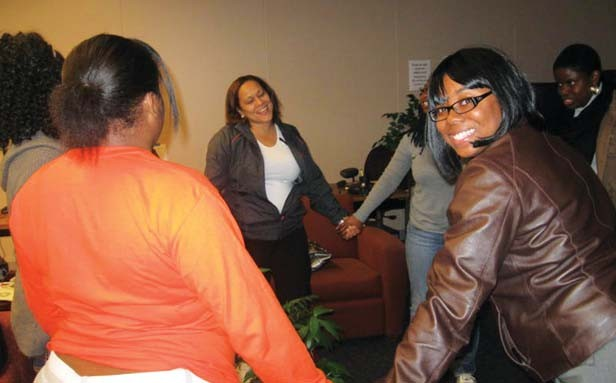 """Jaleesa Earthely-Davis and the other SISTA Project women join hands and cite the SISTA motto:  """"SISTA love is strong, SISTA love is safe, SISTA love is surviving!"""" - COURTESY SPRINGFIELD URBAN LEAGUE"""
