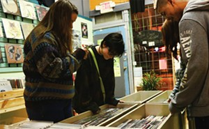 Smart shoppers comb through the stock at Dumb Records. - PHOTOS BY PATRICK YEAGLE