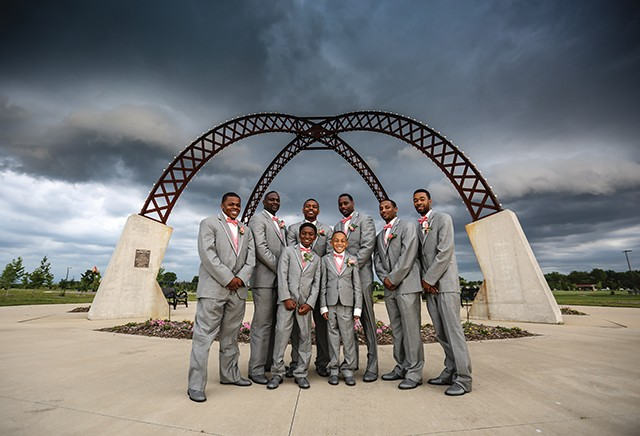 Marcus Bates and his groomsmen fought the storm for some fun photographs at Southwind Park. - PHOTO BY HJS PHOTOGRAPHY
