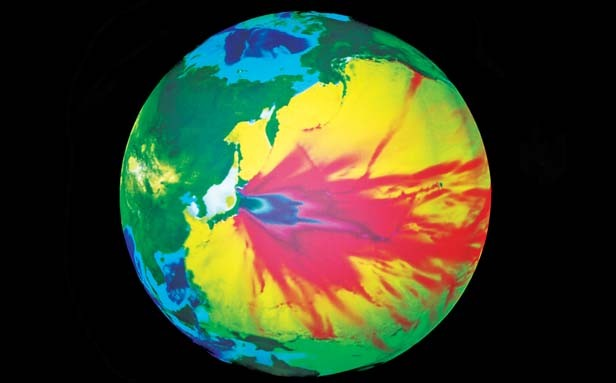 "The ""Science on a Sphere"" globe, updated daily, displays National Oceanic and Atmospheric Administration data on the dispersion of the Tsunami waves following the Japan earthquake."