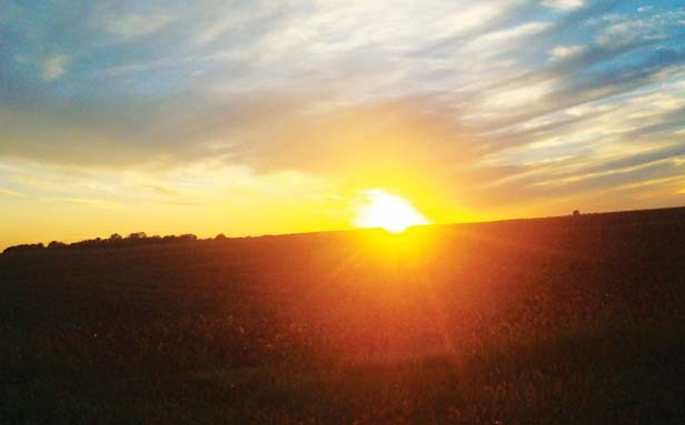 """First place, Ty Dyson, Chatham. Five-year-old Ty Dyson took this photograph, """"A Sunset to Remember,"""" of the setting sun on the west side of the Village of Chatham"""
