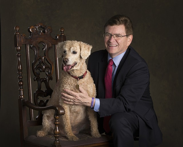 """Mayor Jim Langfelder with Rigley The Langfelders are life-long Cubs fans, so their first family pet was named after the famous field. This Rigley is missing a """"W,"""" because they thought this spelling was more fitting for a girl. Since joining t"""