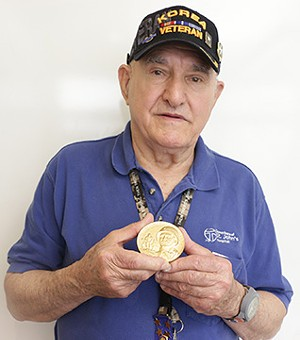 Ivan Maras of Springfield holds his Congressional Gold Medal, awarded to the 65th Infantry Regiment last month.