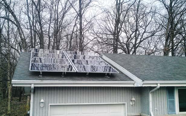 Bob Croteau's 2-kilowatt solar panel generates enough electricity to run his air conditioner in summer.