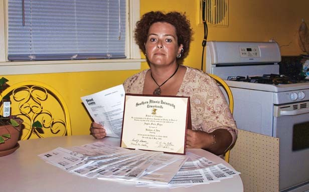 Angela McGonigle with her student loan invoices and the degree the loan financed. A working single mother, McGonigle borrowed $27,000 but now owes $45,000. - PHOTO BY DAVID HINE