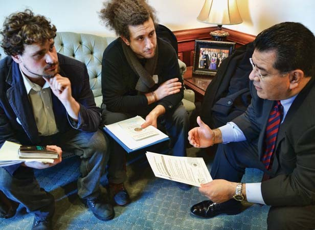 Craig Sadur (left) and Alex Poltorak (center), farmers from Urban Canopy, a rooftop farm in Chicago, discuss composting reform with Sen. Martin Sandoval, D-Cicero. - PHOTO BY JACQUELINE MUHAMMAD
