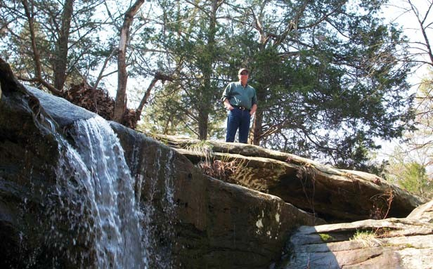 Keith Ladage and a waterfall at Bell Smith Springs. - PHOTO BY CINDY LADAGE