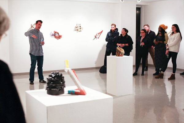 "Artist Tyler Lotz addresses attendees at the ""Oblique Frontiers"" opening on Jan. 26. - PHOTO COURTESY UIS GALLERY"