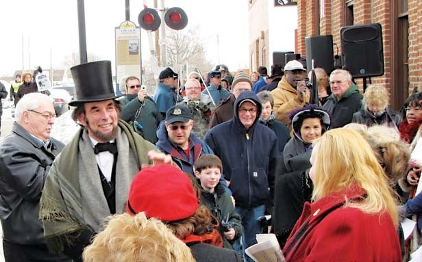 Fritz Klein of Springfield, portraying president-elect Abraham Lincoln, arrives at the Lincoln Depot for the Feb. 11 reenactment of Lincoln's Farewell Address. - PHOTO BY LARRY SENALIK