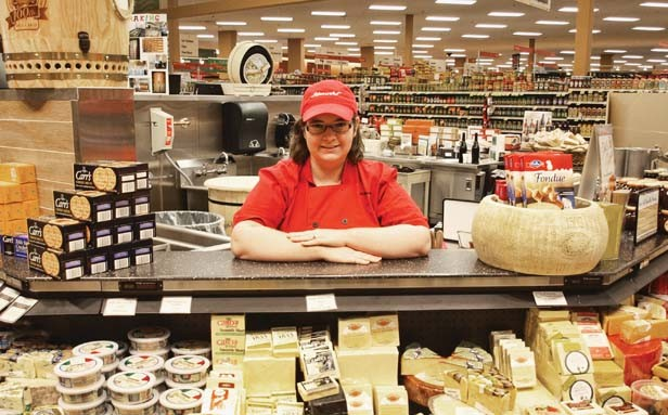 Monvale Schnucks specialty cheese counter manager Leah Reel knows cheese and Schnucks stores offer more than 200 kinds. - PHOTO BY DAVID HINE