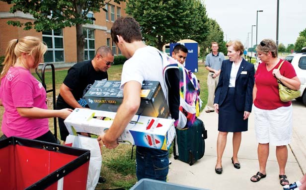Chancellor Susan Koch meets students as they move onto campus. - PHOTO COURTESY UNIVERSITY OF ILLINOIS AT SPRINGFIELD