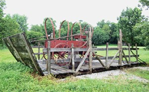 Near the Trail of Hope are replicas of the covered wagons and wooden sleds that the Mormons used to cross the Mississippi River. - PHOTOS BY JOHN CAMPER