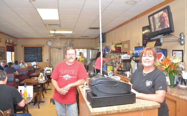 Bill Shroyer and his former employer, Debbie Hill, are both enthusiastic supporters of work-release. Debbie's Diner is near the Adult Transition Center in Decatur and has employed numerous men from the work-release program. - PHOTO BY GINNY LEE
