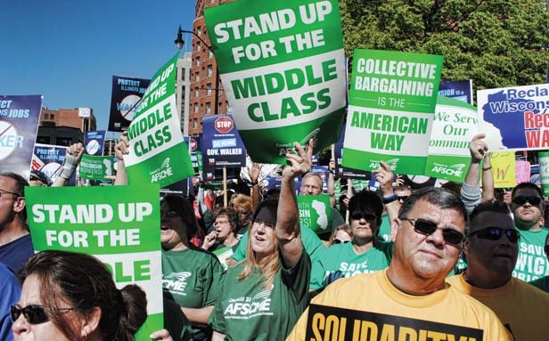 AFSCME Council 31 members protest outside the President Abraham Lincoln Hotel in downtown Springfield during the visit of Wisconsin Gov. Scott Walker, whom the Illinois Chamber of Commerce invited to speak in April about this state's business - PHOTO COURTESY OF AFSCME