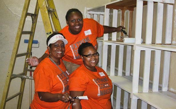 Chapter president Candice Trees, left, along with sorority members Tiffany Lott and  Keneisha Boozer paint during the Harvard Park makeover.