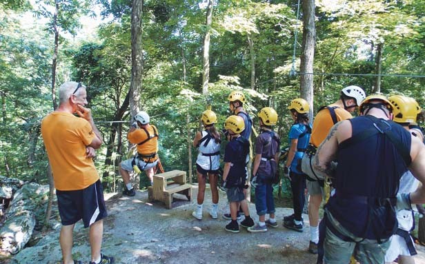 A tour group prepares to launch on one of eight zip lines of the Shawnee Bluffs Canopy Tour. - PHOTO BY ROSE HAMMITT