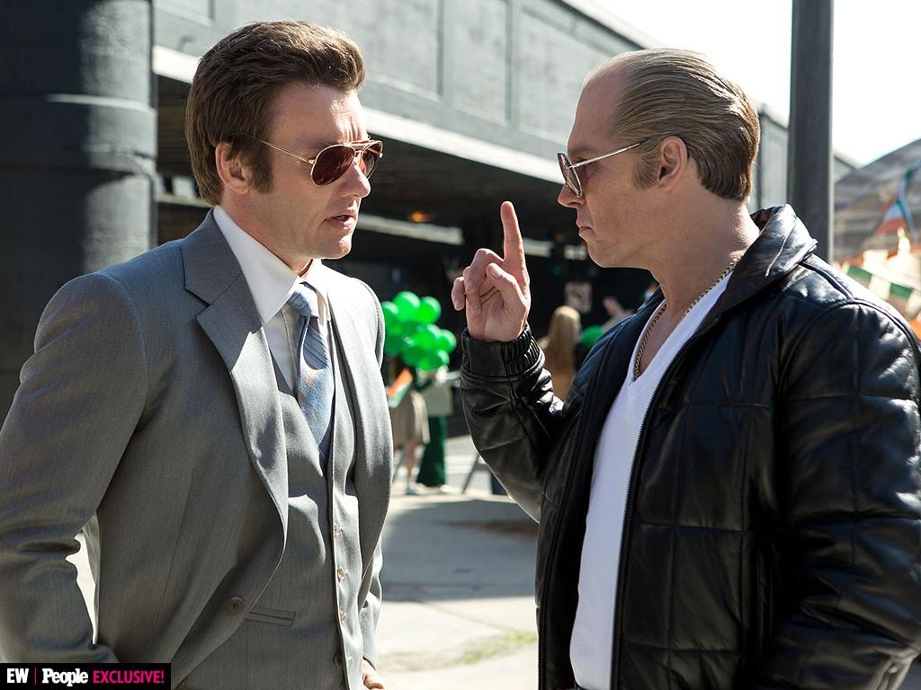 """FBI Agent John Connolly (Joel Edgerton) and White Bulger (Johnny Depp) make nefarious plans in """"Black Mass."""" - COURTESY WARNER BROTHERS"""