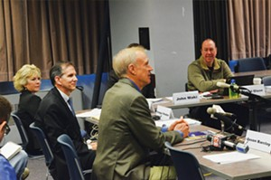 Gov. Bruce Rauner addresses the commission on Jan. 14, encouraging the group of experts to remove hurdles to an inmate's rehabilitation. - PHOTO BY LEE MILNER