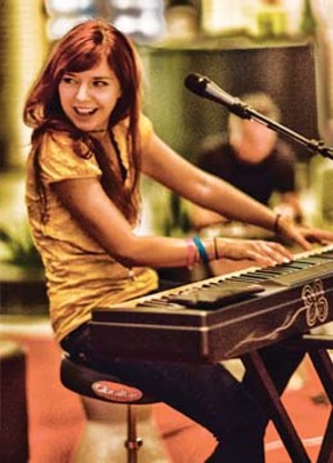 Marina V hard at work playing and singing