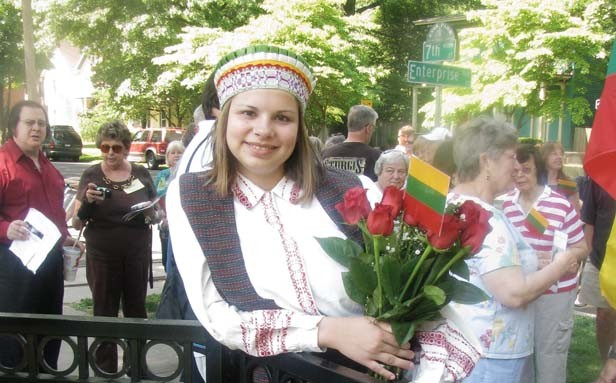 Kourtney Baker, a fourth-generation Lithuanian-American and student at Sacred Heart-Griffin High School, donned traditional dress for the historical marker unveiling. She plans to visit Lithuania with her mother after graduation. - PHOTO BY WILLIAM FURRY