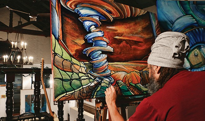 Local artist Jeff Williams at work in  The Pharmacy Gallery and Art Space. - PHOTO BY PATRICK YEAGLE