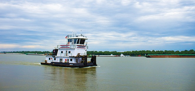 The Shawnee Forest towboat steers down the Ohio River near American Commercial Barge Line's office outside Cairo. As of June 12, there were more than 600 barges waiting to go upstream when water levels drop. - PHOTOS BY MADELYN BECK