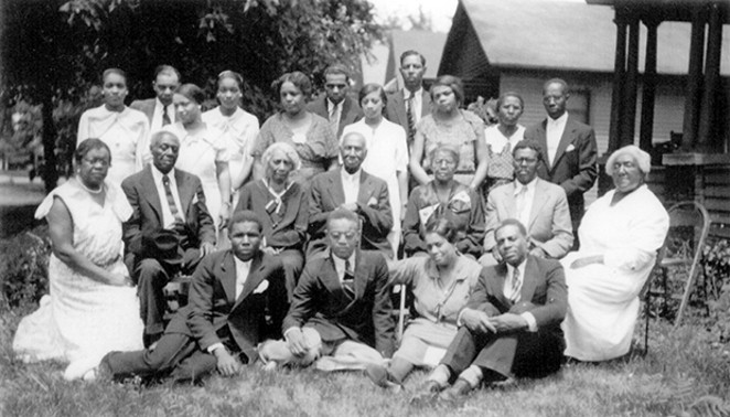 A 1930s family gathering at 1611 East Jackson St. after the funeral of Thomas Artis, patriarch of the Artis family. - COURTESY SANGAMON VALLEY COLLECTION, LINCOLN LIBRARY
