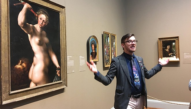 Museum Hack tour guide Colin in front of the mid-16th century painting Judith by Jan Sanders van Hemessen, explaining how the biblical heroine saved her people by chopping off the head of the drunken Holofernes. - PHOTO BY KAREN WITTER