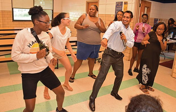 Julio Barrenzuela dances with Springfield Urban League Summer Camp participants at Washington Middle School. - PHOTOS BY DAVID BLANCHETTE