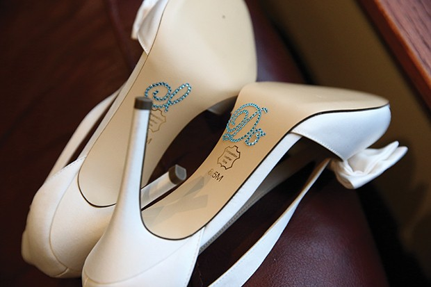 Sarah Houran added something blue to the bottom of the shoes she wore on her wedding day. - PHOTO BY CHAD MITCHELL