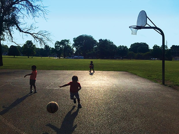 Teens at Jaycee Park shared their basketballs so M and B and their cousin could hoop. - PHOTO BY JESSICA HANDY