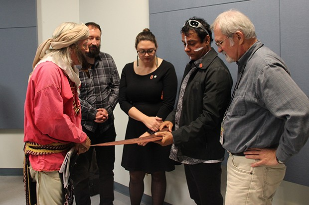 Russell Davey showing details of the boomerangs. L-R: George Godfrey (Potawatomi), Travis Booth, Brooke Morgan, Russell Davey (Bardi Jawi), and Terrance Martin. - PHOTO BY DANNYL DOLDER