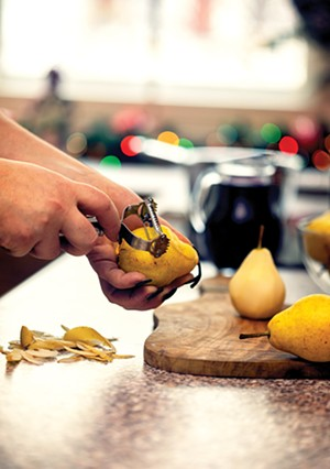 Preparing poached pears.