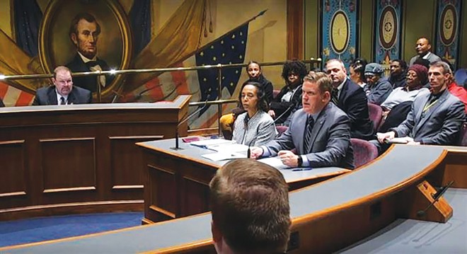 Illinois State Police Director Brendan Kelly and Robin Woolery, the assistant deputy director for ISP's forensic science department, testify Tuesday before the Senate Public Health Committee in Springfield. The committee met to discuss the state's backlog of untested forensic evidence. - PHOTO COURTESY BLUEROOMSTREAM.COM