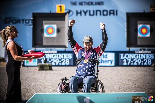 Ben Thompson accepts 2019 World Championship Gold medal at the World Archery Para Championships in Hertogenbosch, Netherlands. - PHOTO COURTESY OF USA ARCHERY